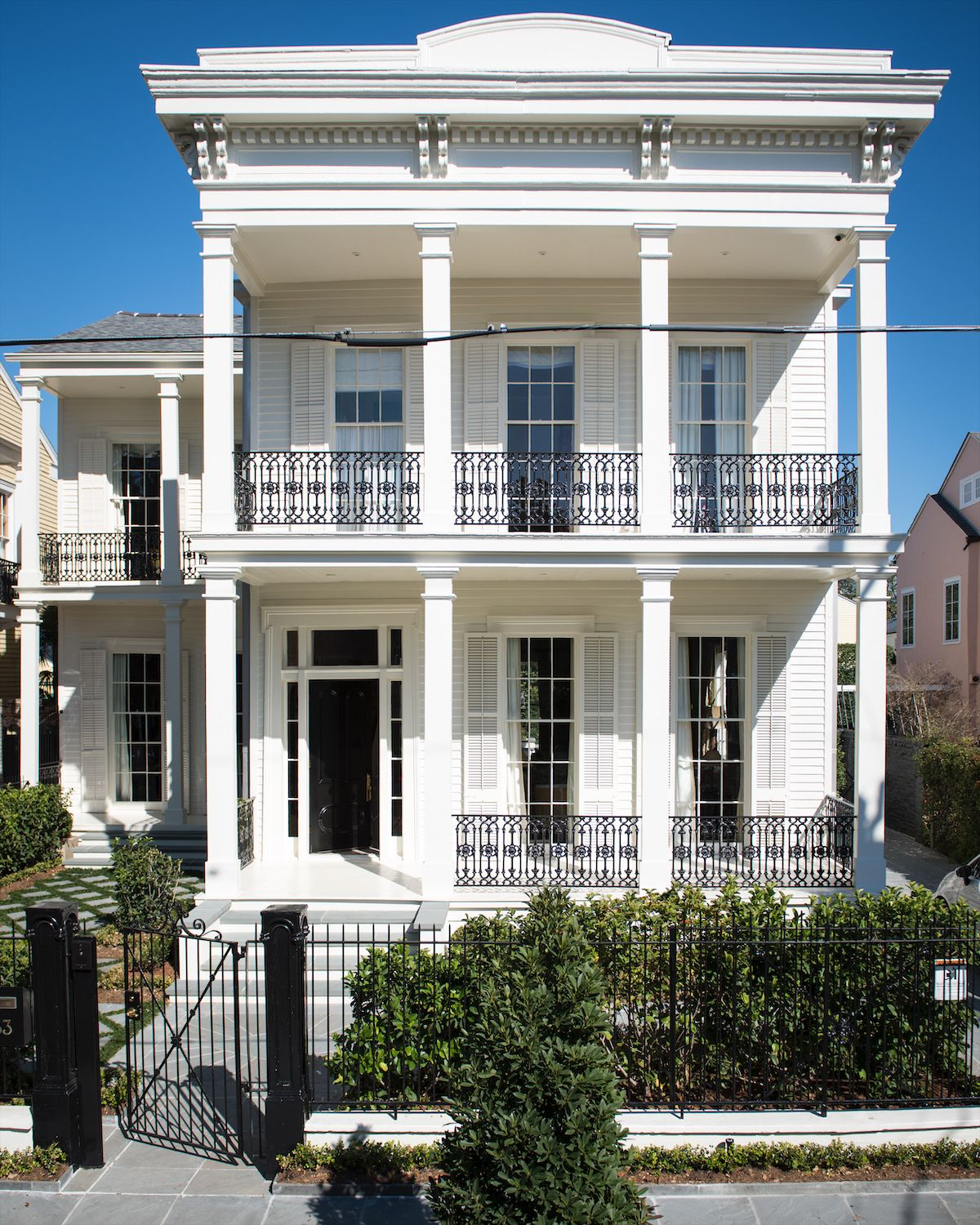Inside A Luxury Linen Designer S Jewel Box Home In New Orleans Historic Garden District Papercity Magazine New Orleans Homes Greek Revival Home House Exterior