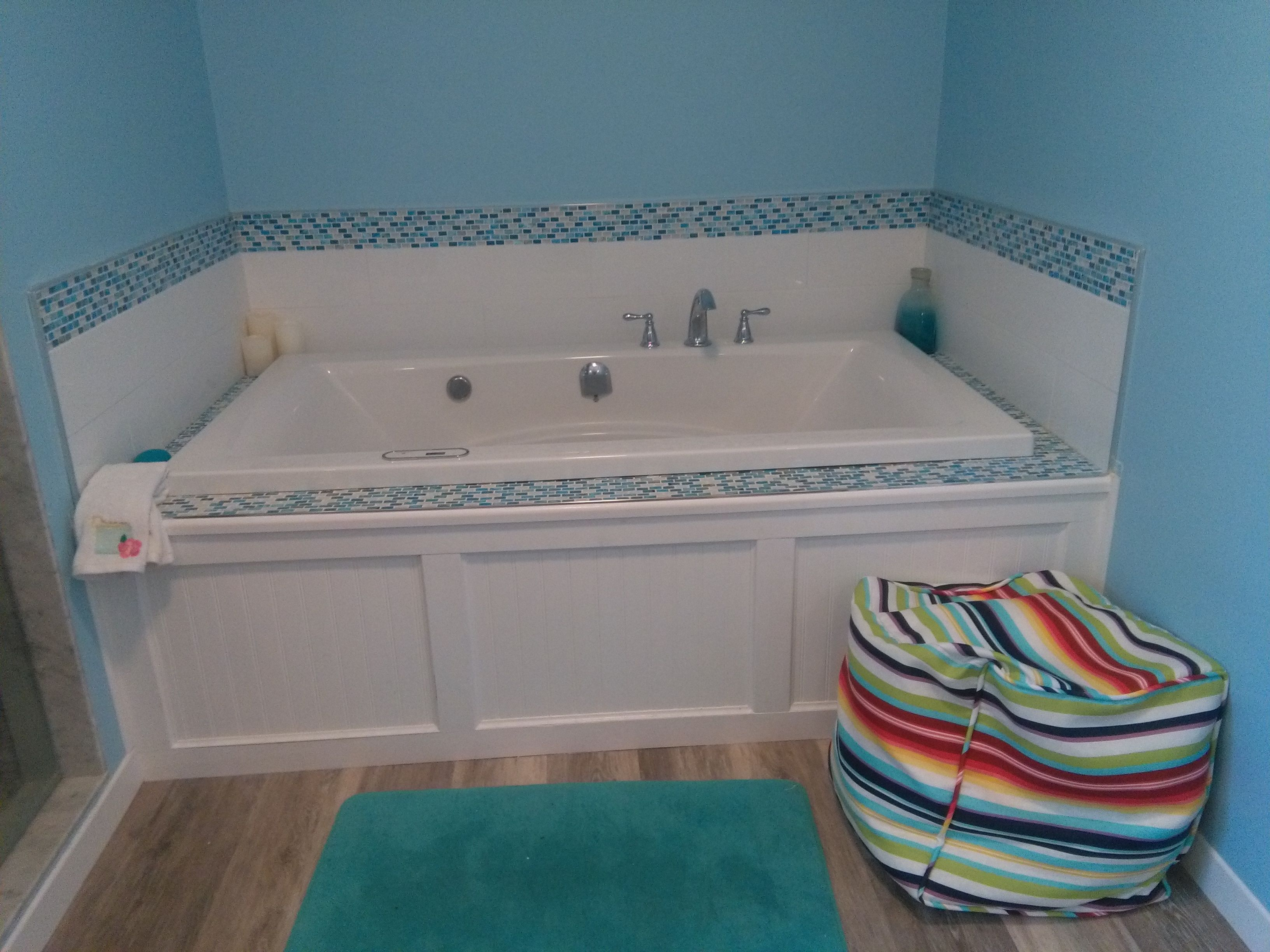 7 foot tub for my 6 foot boys/men. Pouf since my family is very ...