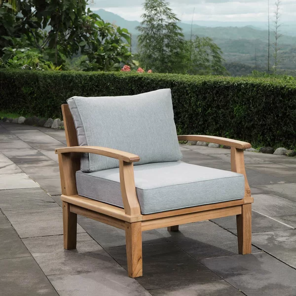 Crafted From Teak Wood And Showcasing Water Resistant Cushions This Understated Patio Armchair Teak Patio Furniture Gray Patio Furniture Resin Patio Furniture