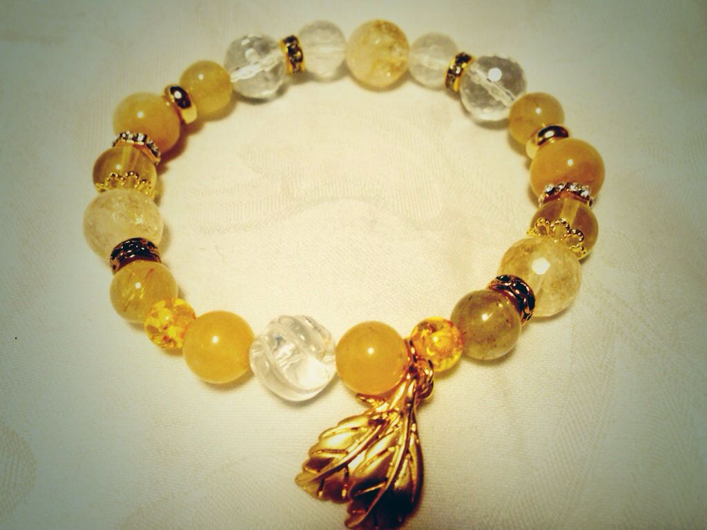 Golden Leaves. Citrin, rock crystal, yellow jade, yellow fluorite, imitation amber, gold rutile-quartz