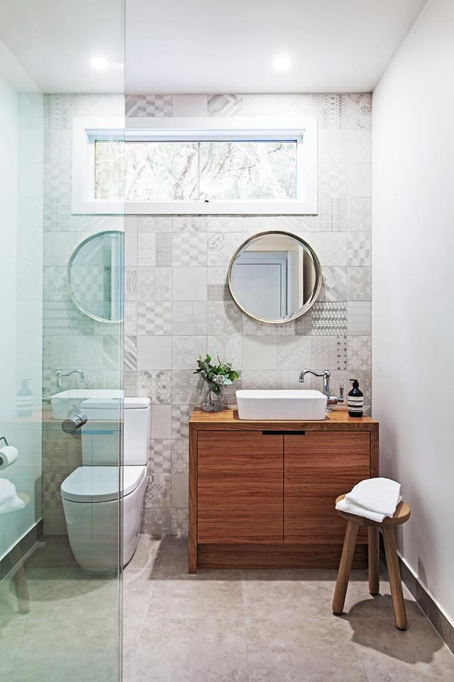 feature tile wall in light neutral tones combined with