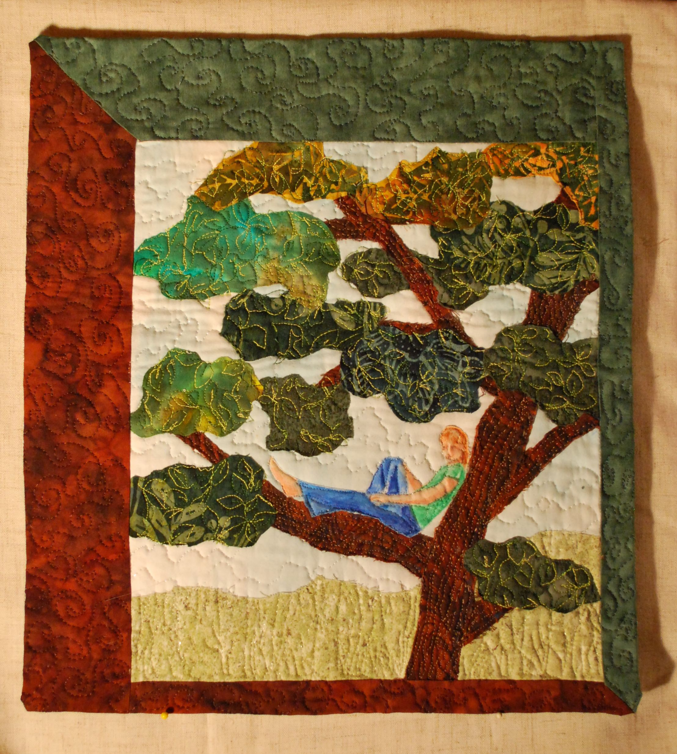 Raw-edge applique of a 'Childhood Memory.'  In my case climbing the buckeye tree in our yard.  Figure was painted and appliqued.  Quilted heavily for texture.