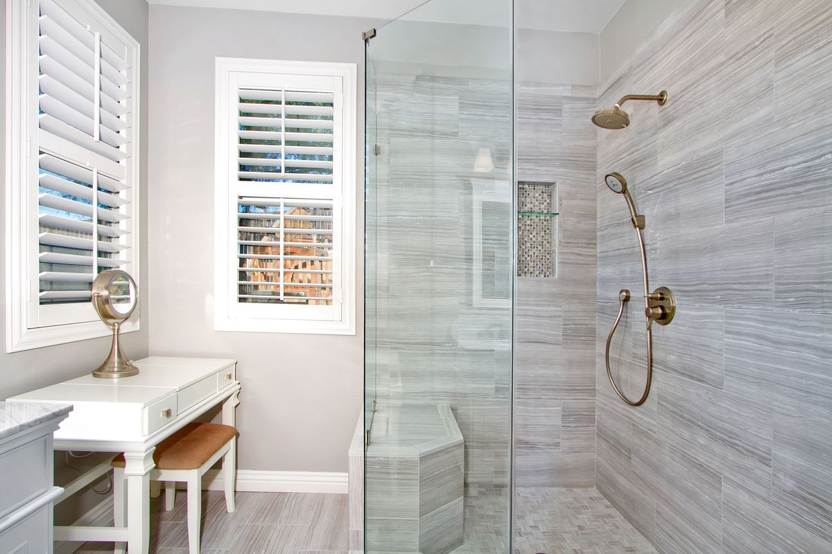 A walk in shower with a beauty area makes for a dream bathroom ...