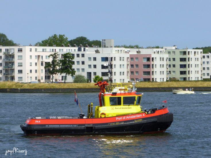 Port of Amsterdam pilot ship cruising the river IJ (pronounced as 'eye')