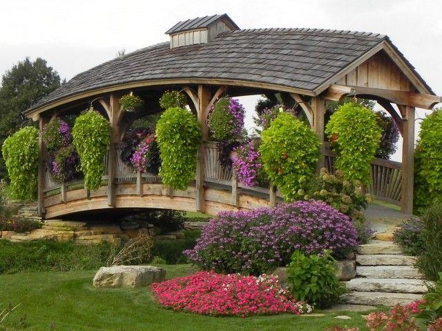 A Beautiful Flower Covered Bridge Located In Carlton Mi At
