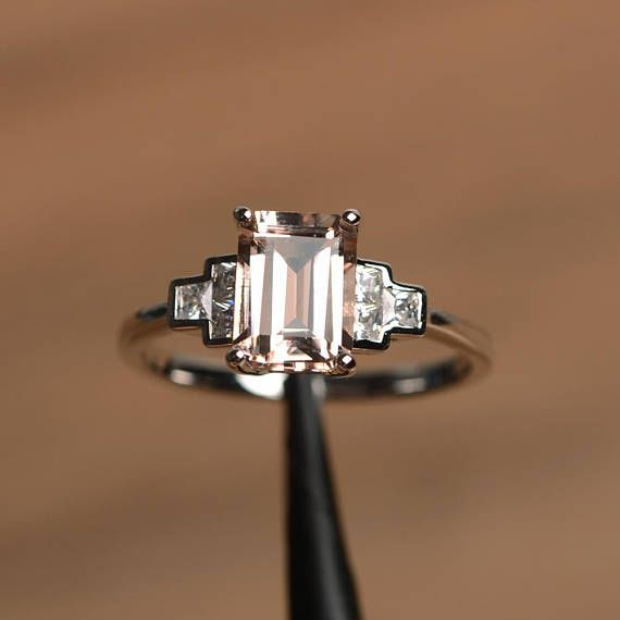 It is a natural morganite ring. The main stone is 6 mm*8 mm emerald cut.weight about 1.48 carats. The basic metal is sterling silver and plated with rhodium. To change the metal to a solid gold (white/rose) or platinum is also available, please ask for a quotation if you want. You can