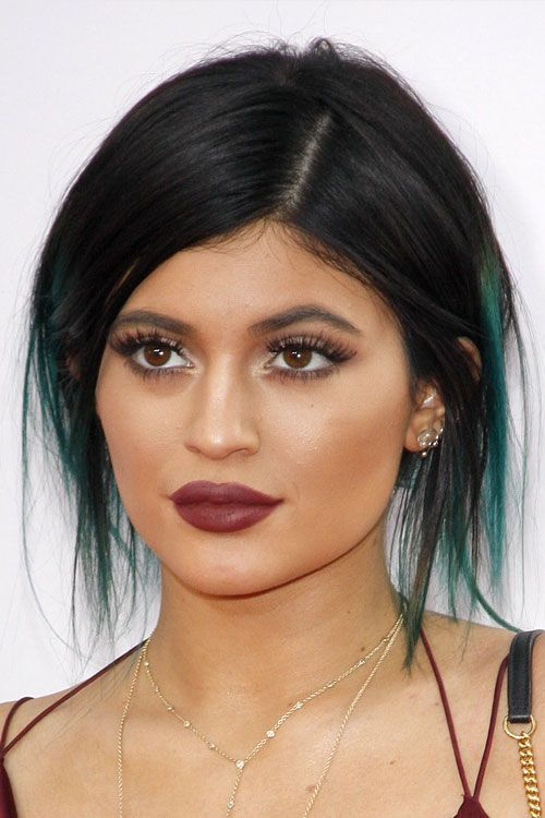 Kylie Jenner Straight Black Peek A Boo Highlights Updo Hairstyle