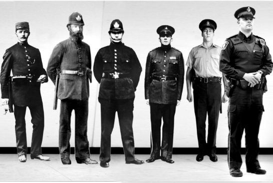 A lineup shows how Toronto police officers' uniforms changed through the  years. From left