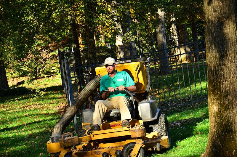 One of our lawn care specialists maneuvering around a