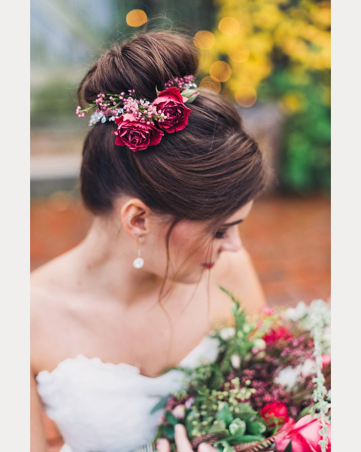 How pretty, the flowers are placed around her bun! ~ we ❤ this! moncheribridals.com