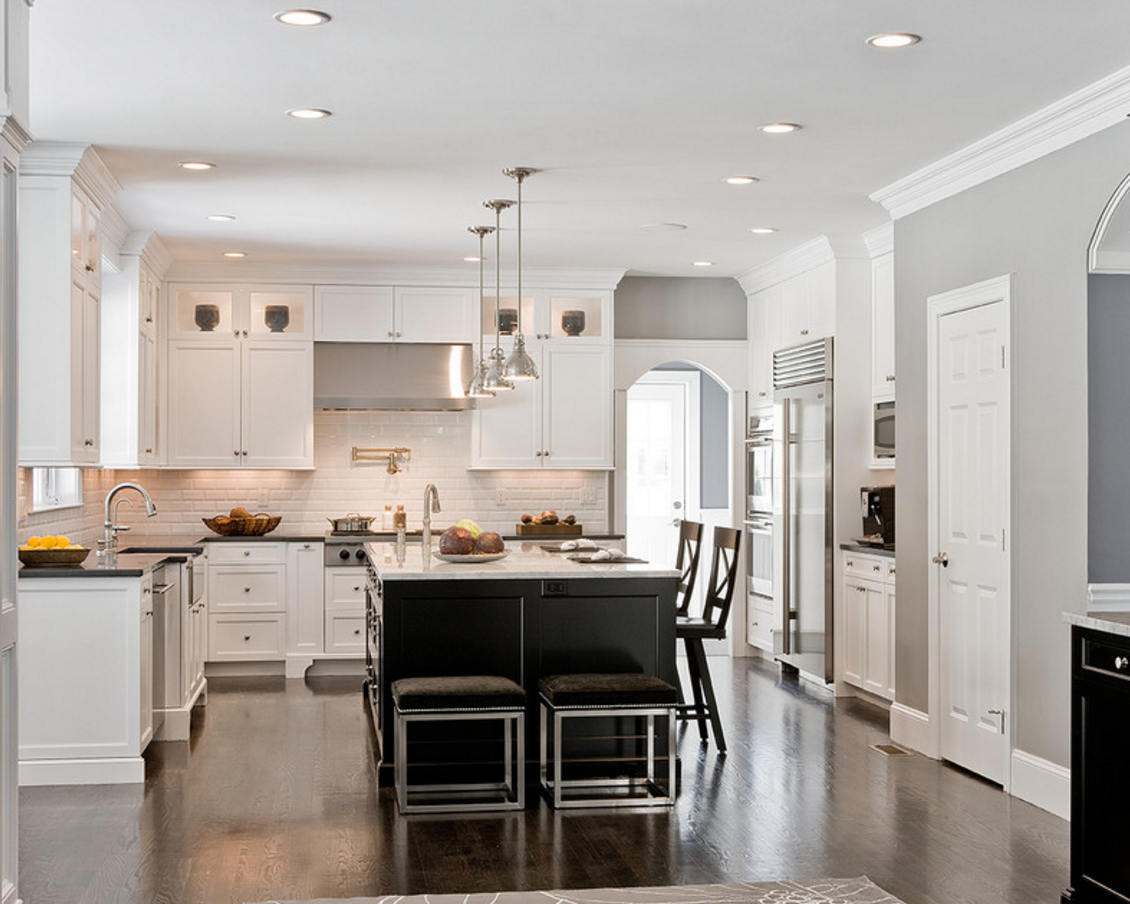 contrasting kitchen: dark island with supreme white quartz cream