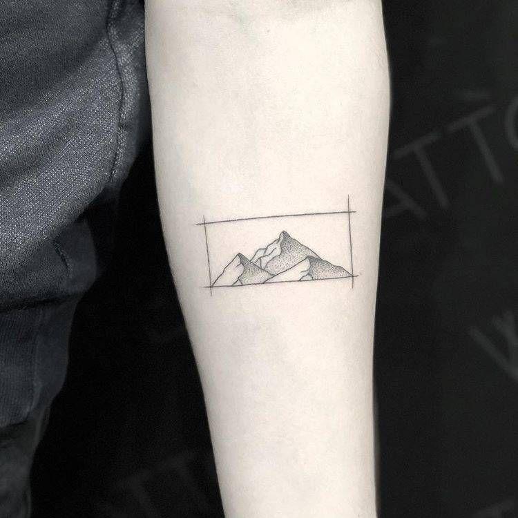 Mountain range tattoo on the left inner forearm