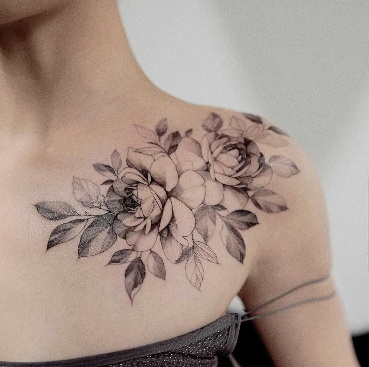 A floral shoulder piece by Zihwa Shoulder tattoos for