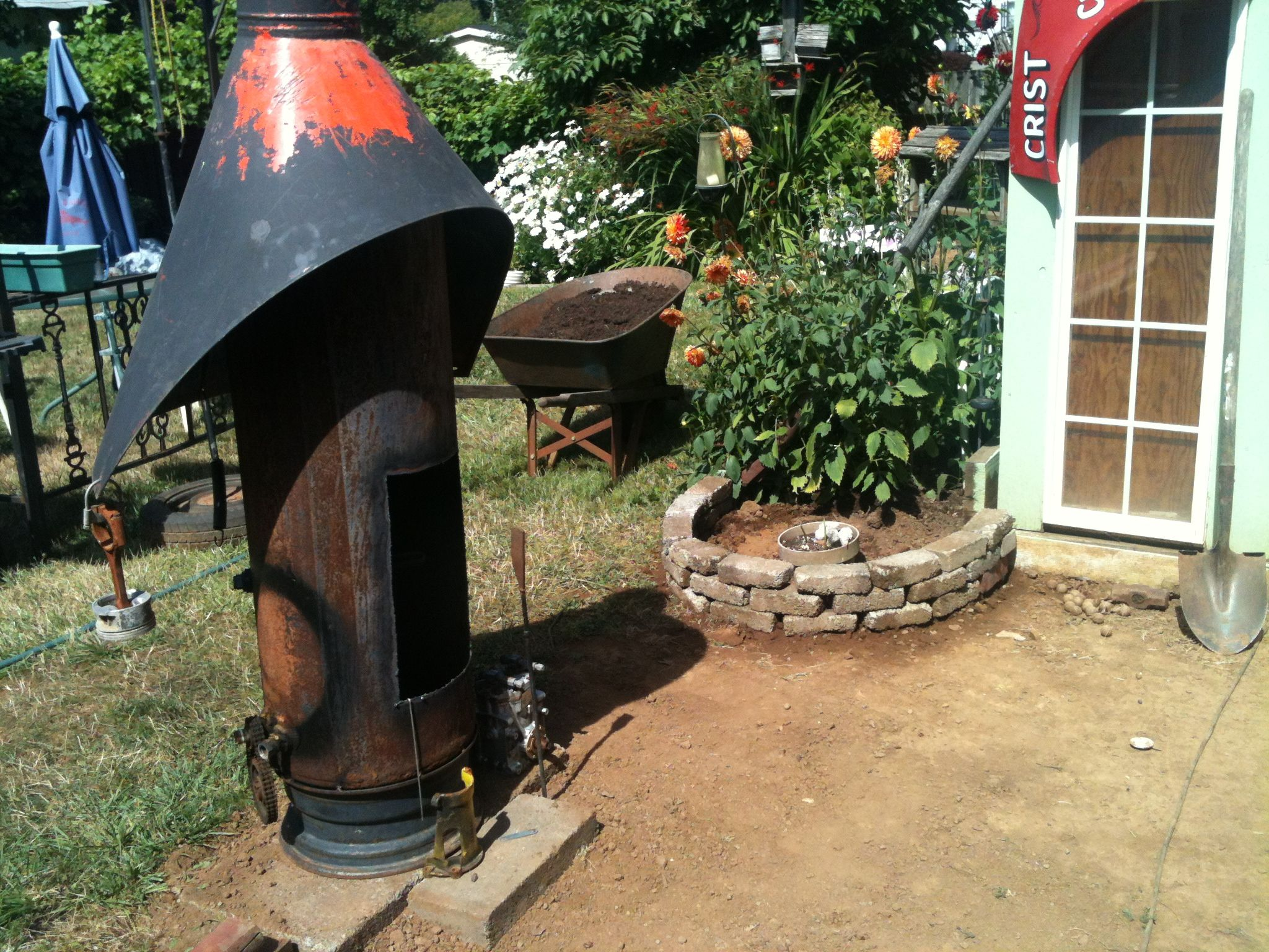 Fire Pit Made From A Hotwater Tank And A Rim And Old Wood