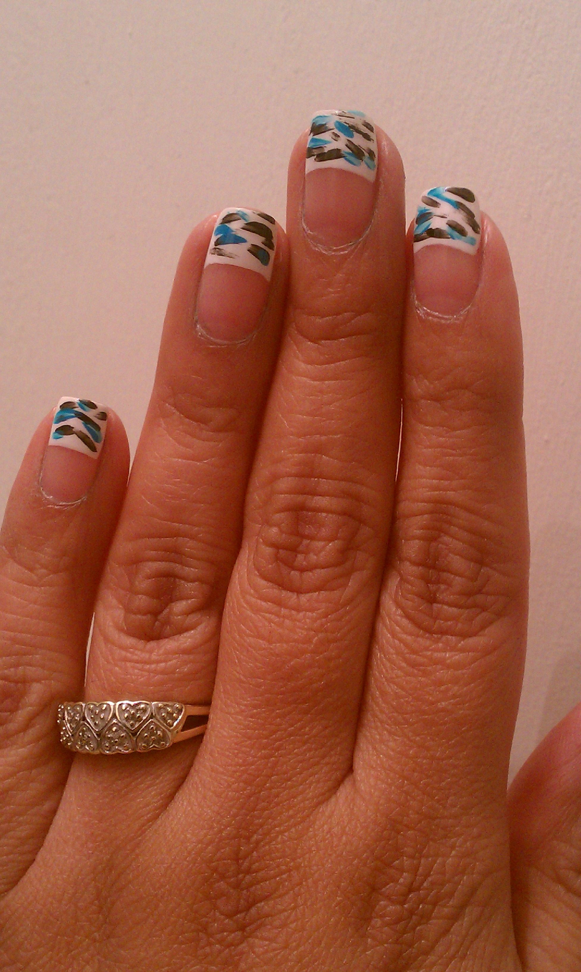Another angle - french tip nails with paint brush stroke accents ...