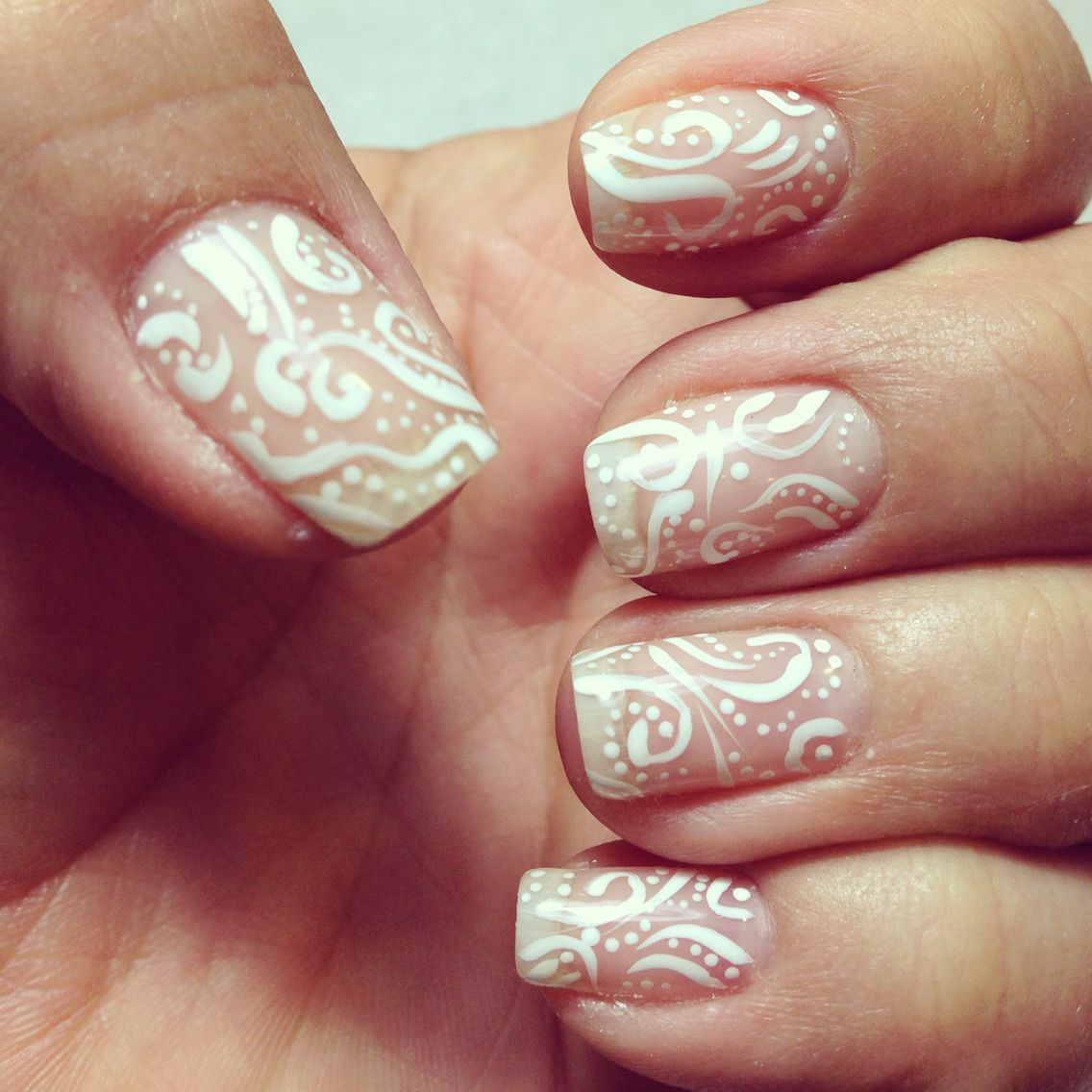 White nail design. Freehand design on clear shelac polish. Good for ...