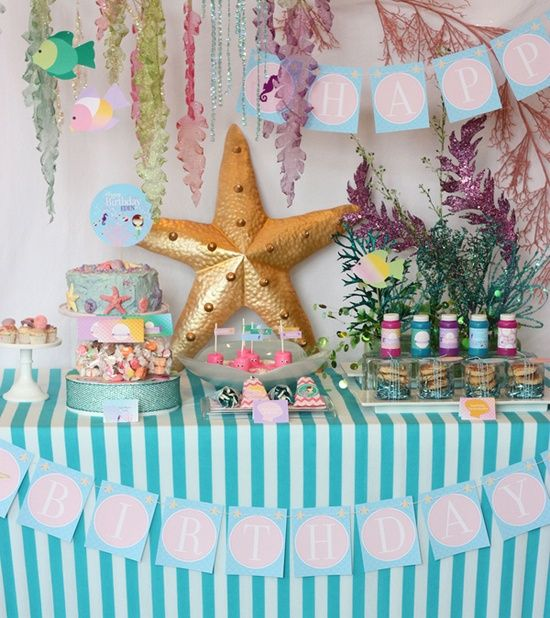 under the sea baby shower - if you look close, looks like they made chocolate dipped marshmallows into pink octopi!