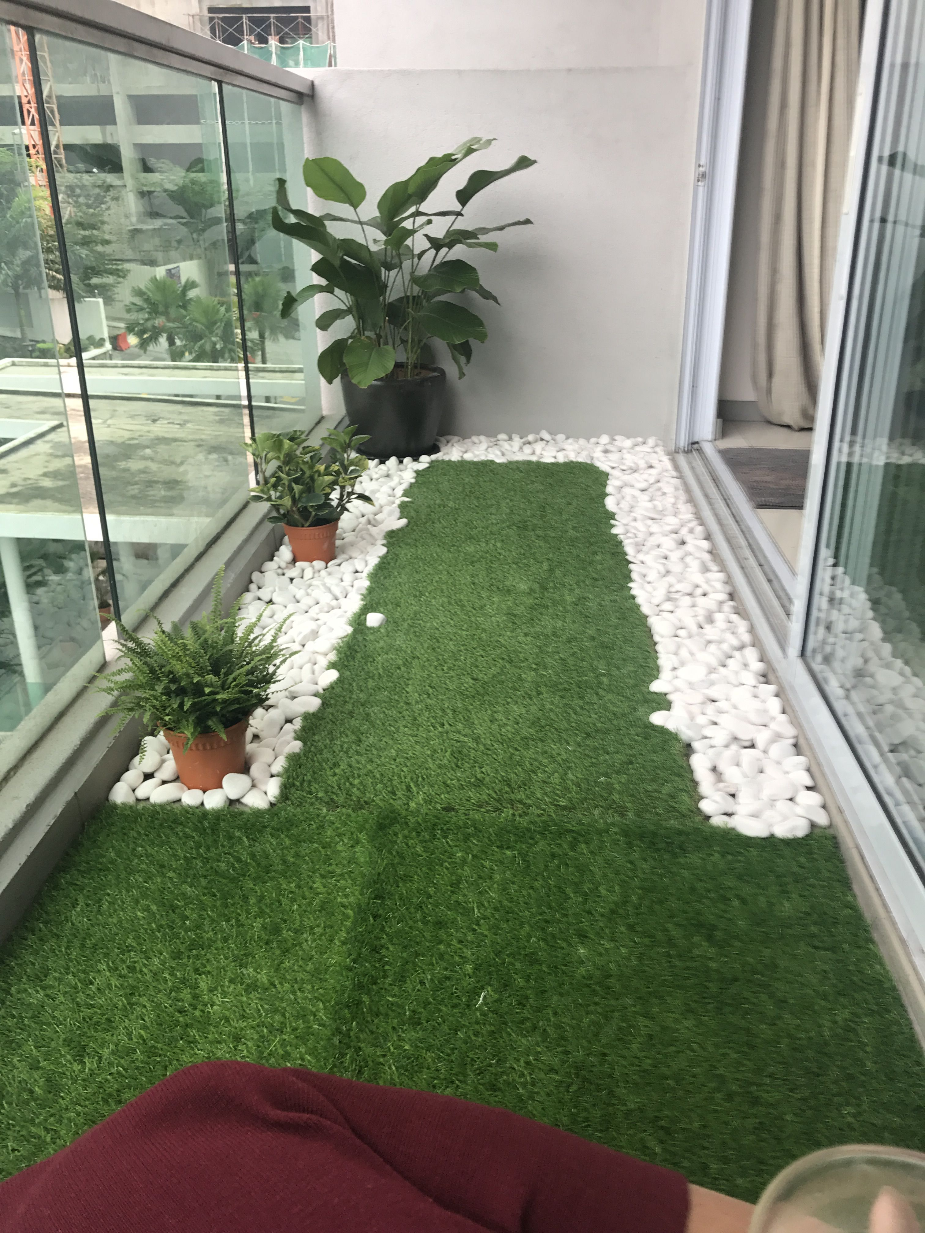 tiny balcony with artificial grass and river pebbles Artificial Garden For Balcony id=54260