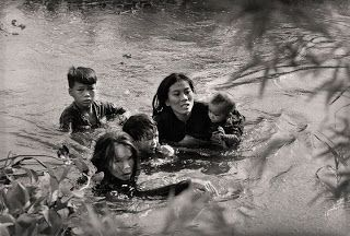 World Press Photo of the Year: 1965  Loc Thuong, Binh Dinh, South Vietnam, September 1965. Mother and children wade across river to escape US bombing.