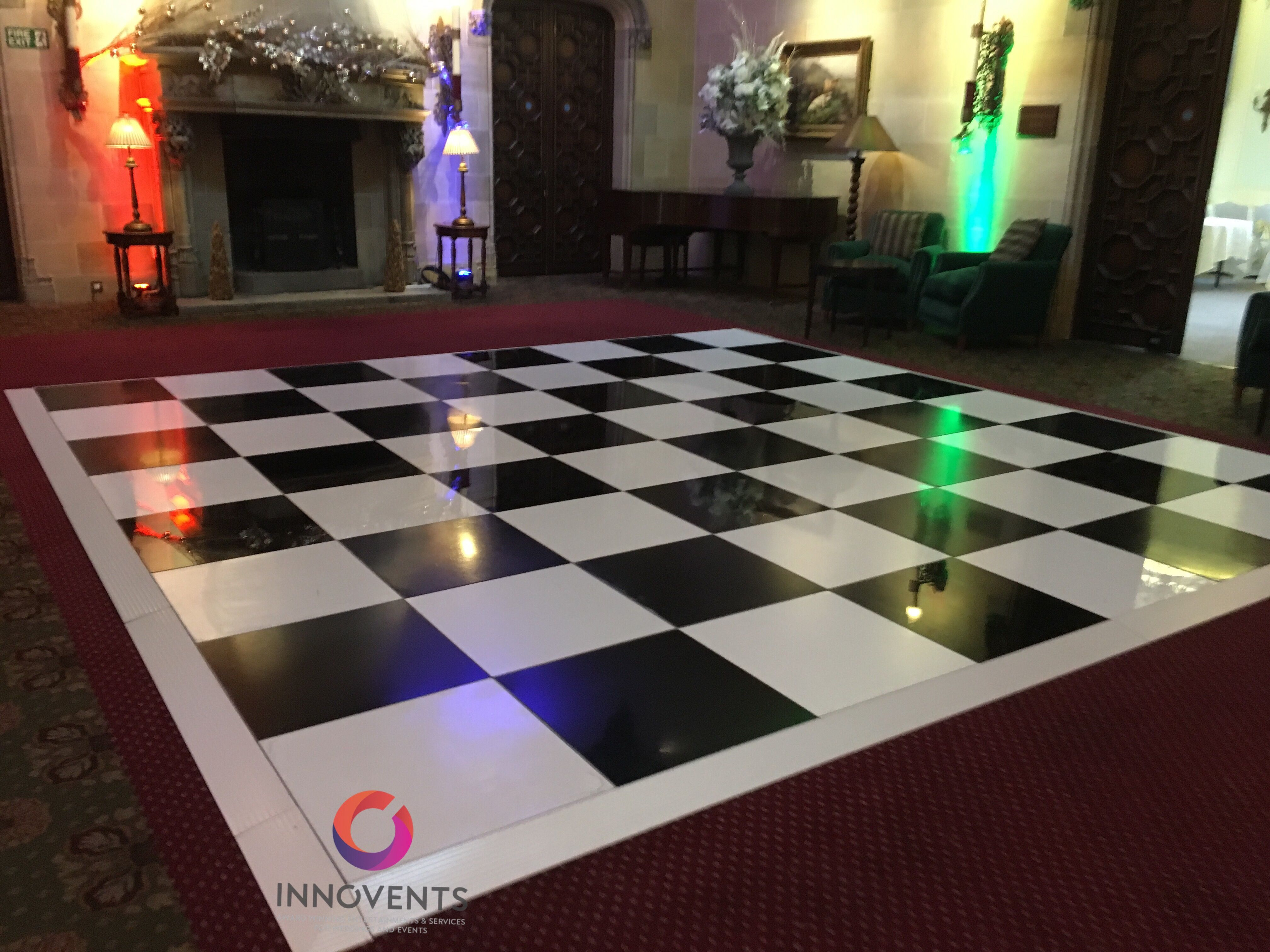 A timeless classic chequered dance floor wrapped with a gloss white