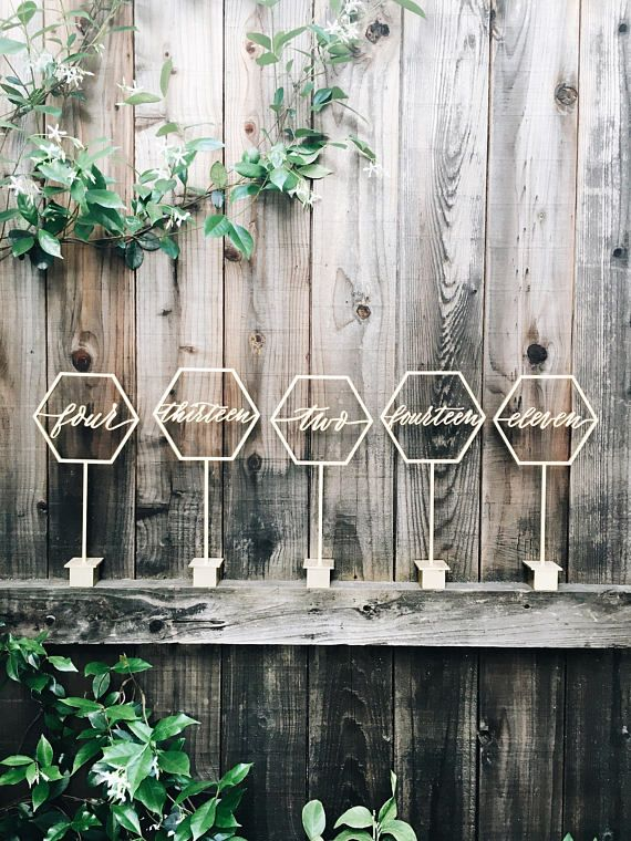 Free-standing hexagon table numbers. Painted gold, rose gold or stained wood - specify in comments section upon purchase. Dimensions: 12in tall x 6in wide