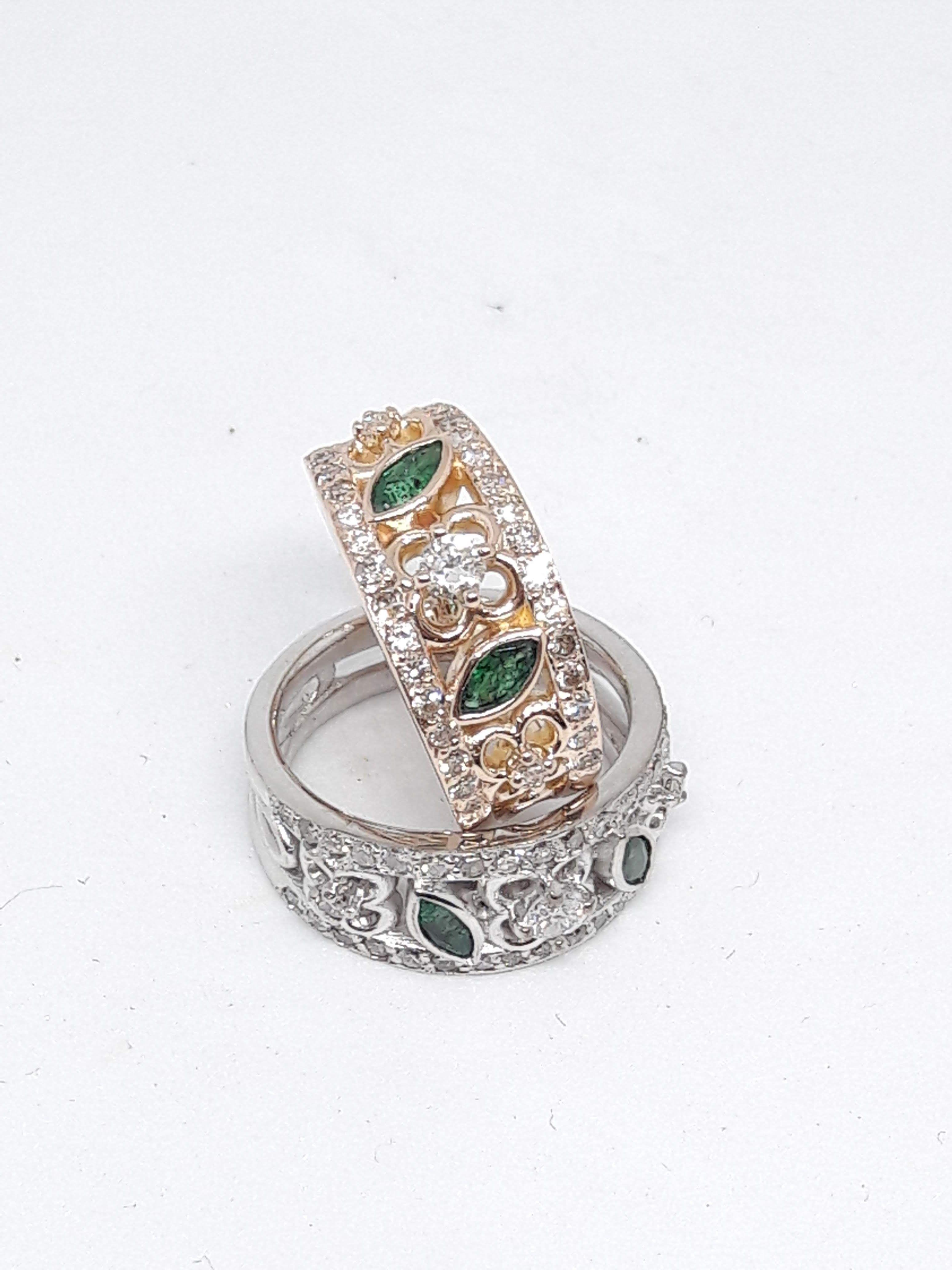 Flower design emerald and diamond rings wedding rings