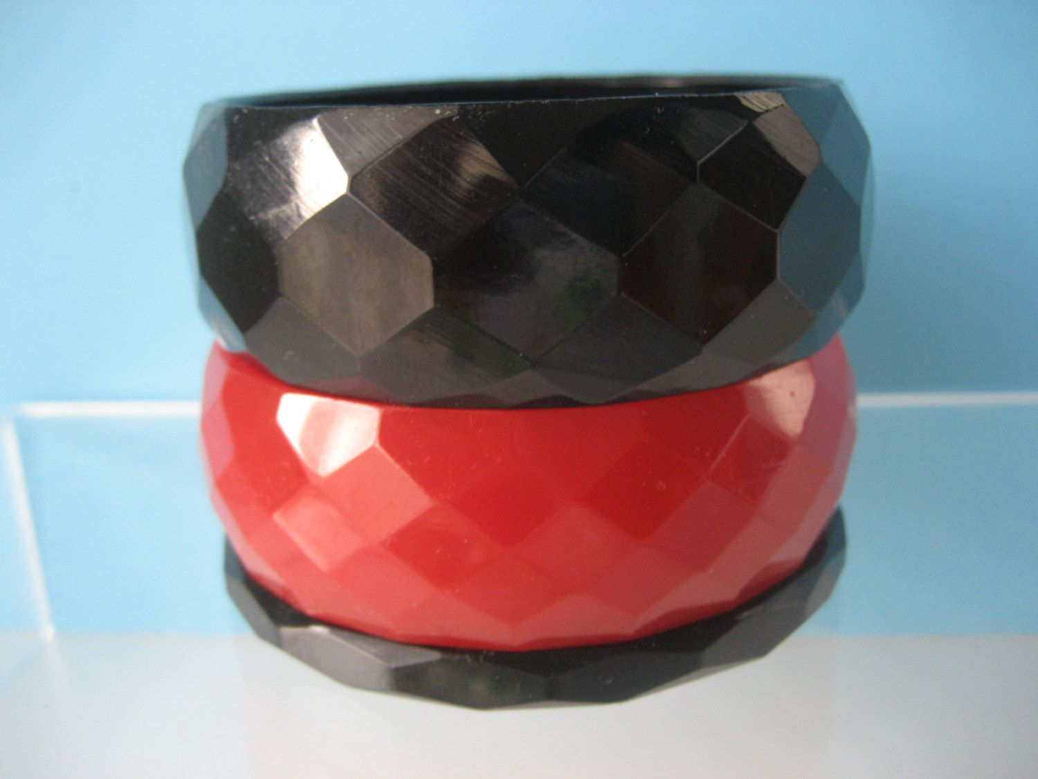 * From my Mom's store.    3 Vintage Art Deco Faceted Carved Bracelets Red & Black tested. $145.00, via Etsy.
