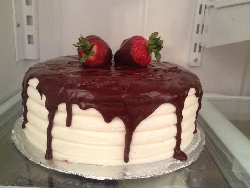 Pretty cake with chocolate dipped strawberries