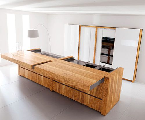 "A ""hidden kitchen"" - panels slide over the stove/oven/sinks and can be pushed out to form tables"