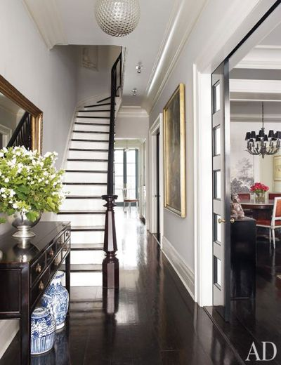 Simple gloss shiny dark wood floors tall baseboards skirting thick crown molding bright white walls large artwork white risers wood treads I toy with Modern - Modern white crown molding Picture