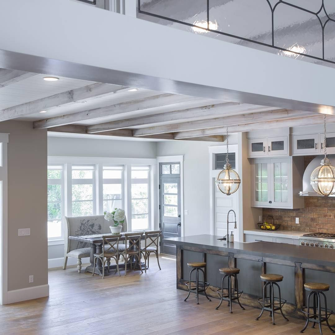 Love the glass balcony above highlandcustomhomes kitchens