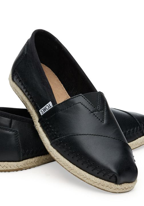 101d332eeac A TOMS espadrille in sleek full-grain leather with a rope sole. Subdued and  stylish