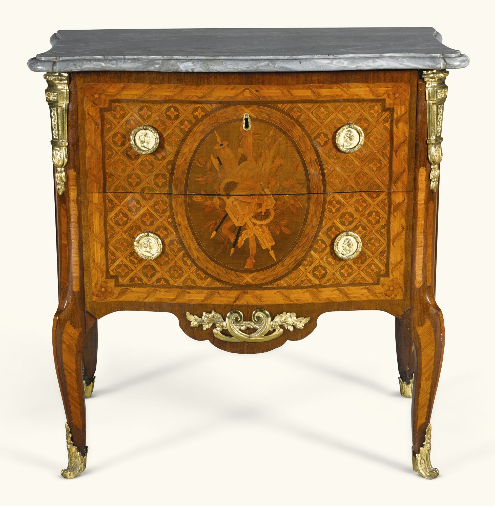 A Transitional gilt-bronze mounted tulipwood and fruitwood marquetry petit-commode by Guillaume Kemp, circa 1770