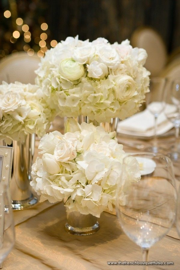 Rehearsal dinner floral arrangements of white in silver for Dinner table flower arrangements