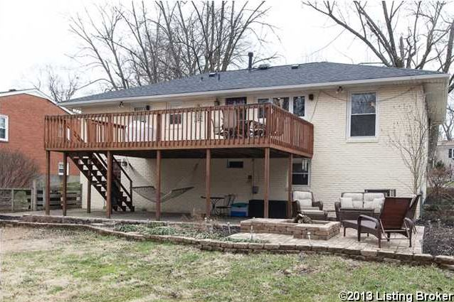 the deck on this rancher with walkout basement provides a roof for