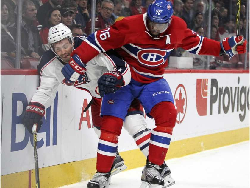 Montreal Canadiens P.K Subban checks Columbus Blue Jackets Boone Jenner during National Hockey League game in Montreal Tuesday December 1, 2015.