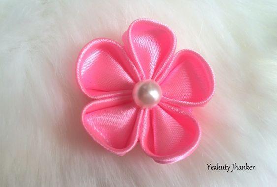 DIY: How to make a Kanzashi ribbon flower. #ribbonflower