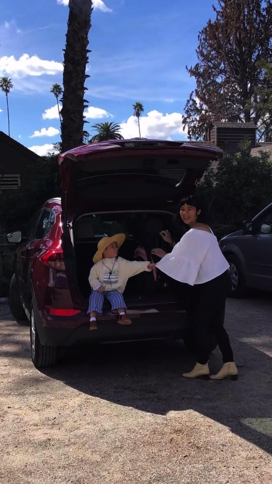 Melissa places the folded-up Peli stroller in the back of her car, with help from her little one, Harrison.  #joowaadreaming #designforchildren #letthembelittle #littleandbrave #livecolorfully #thatsdarling #babylove #babygoods #childhoodunplugged #bringthekids #oureverydaymoments #candidchildhood #littleandbrave #writeyouonmyheart #illuminatechildhood  #livethelittlethings  #lifeofadventure  #bringthekids #writeyouonmyheart #inbeautyandchaos #babyproducts #babyshower #babyshop #mynameismama