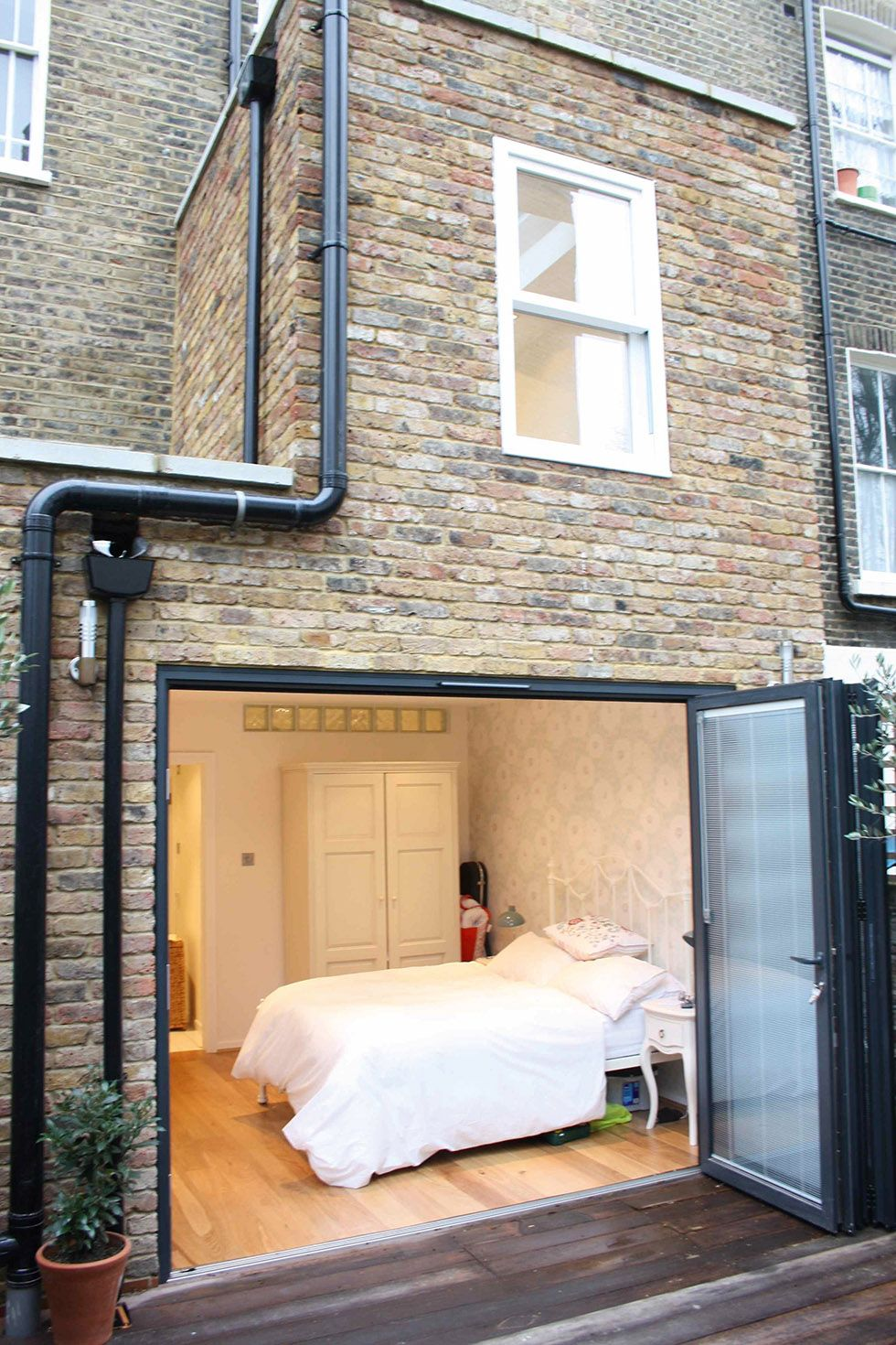 Bedroom With Bi Fold Doors In Two Storey Extension Back Of House