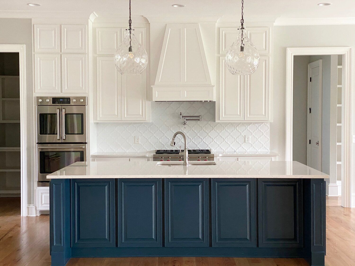 Jennifer Taylor Design Tallahassee Florida Lake Pisgah Project Blue Island White Kitchen Arabesqu In 2020 Kitchen Island Design Linen Cabinets Kitchen Design
