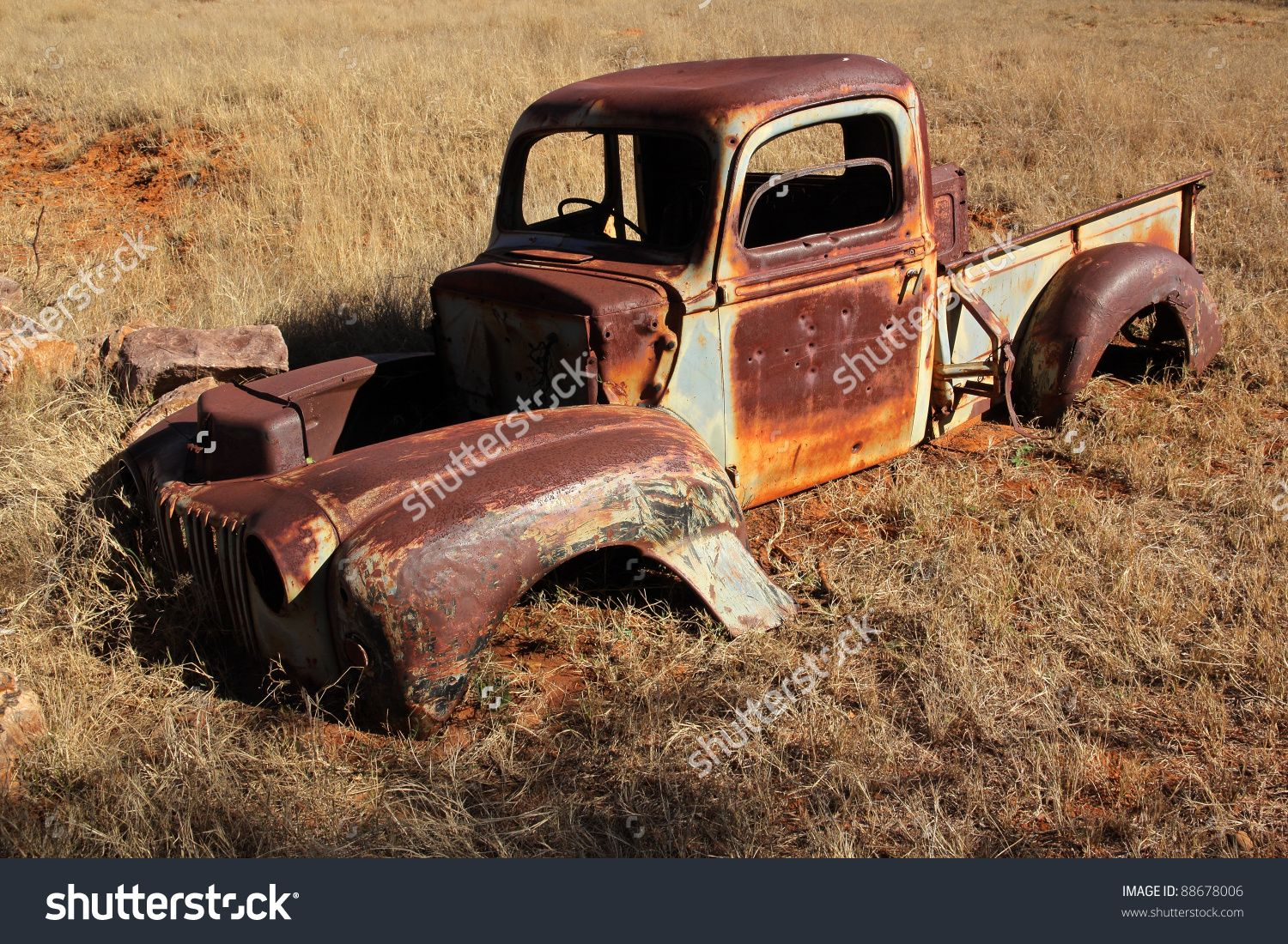 Wreck of a rusty old pickup truck out in the field - stock photo ...