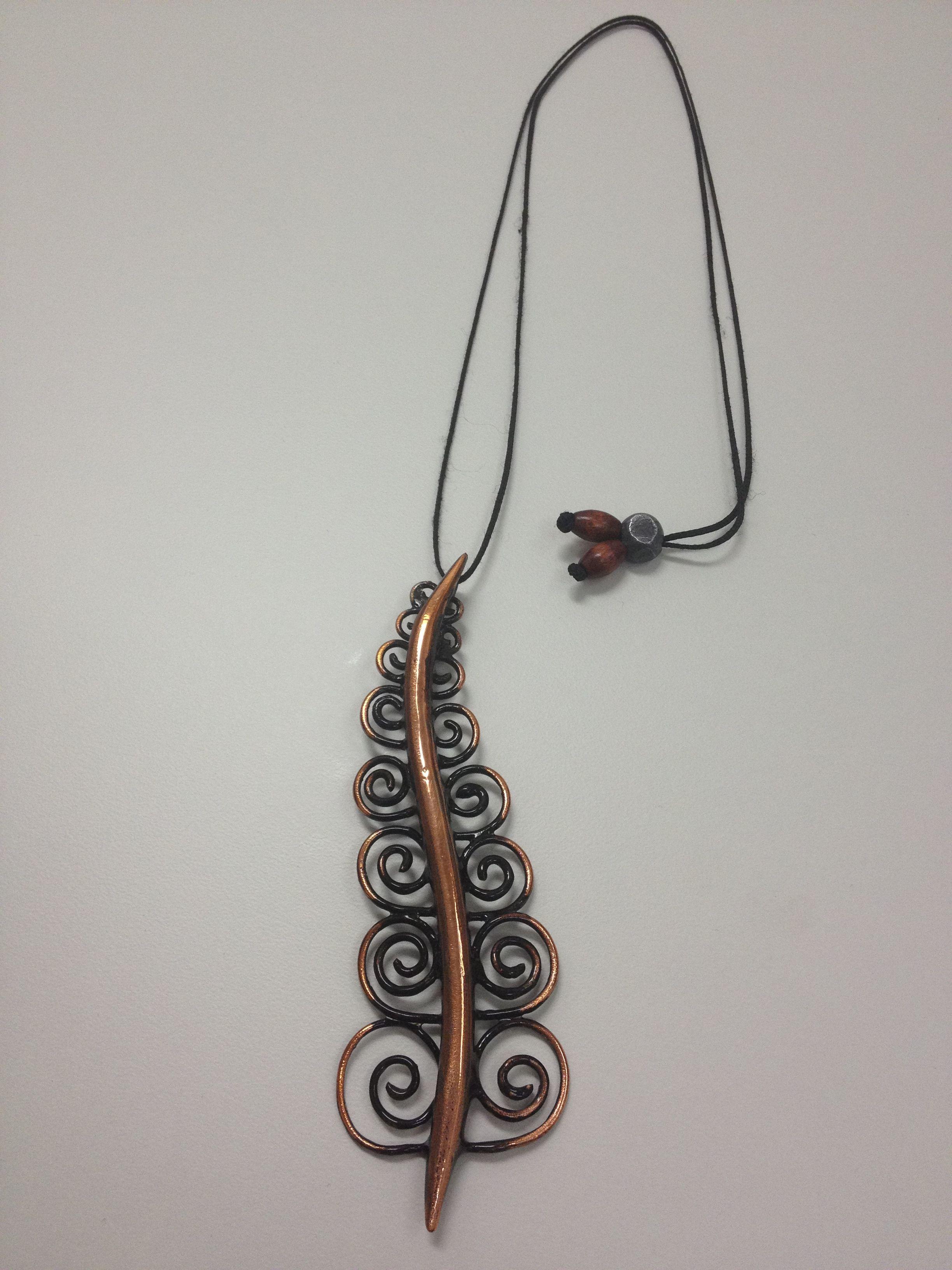 Artache jewelry design in New Zealand. Maori design made from burnt ...