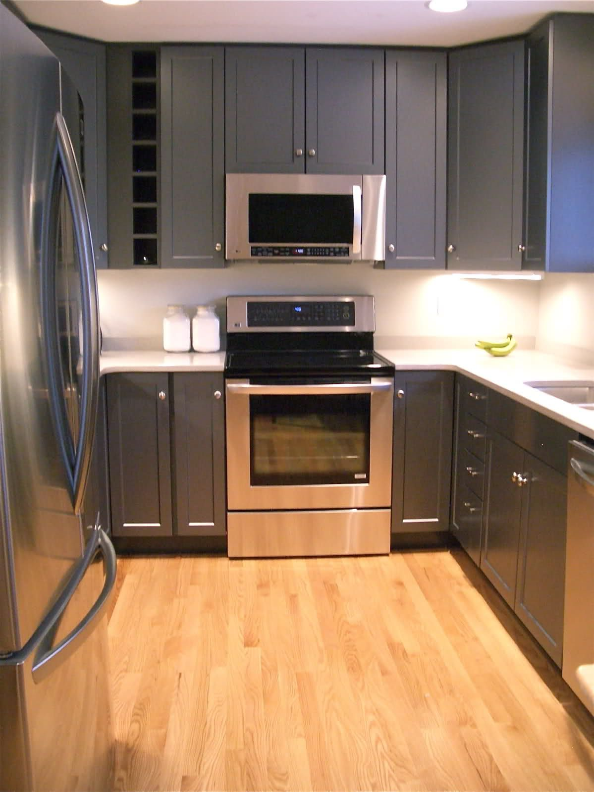 dark gray cabinets with white quartz countertops our house kitchen cabinets wood floor. Black Bedroom Furniture Sets. Home Design Ideas