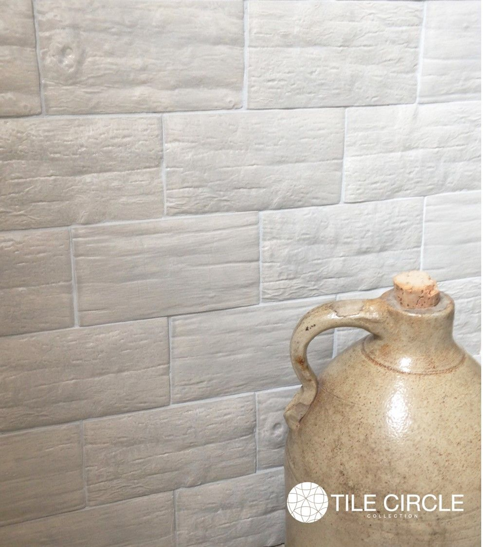 The differences between porcelain and ceramic tile. Handmade Grey