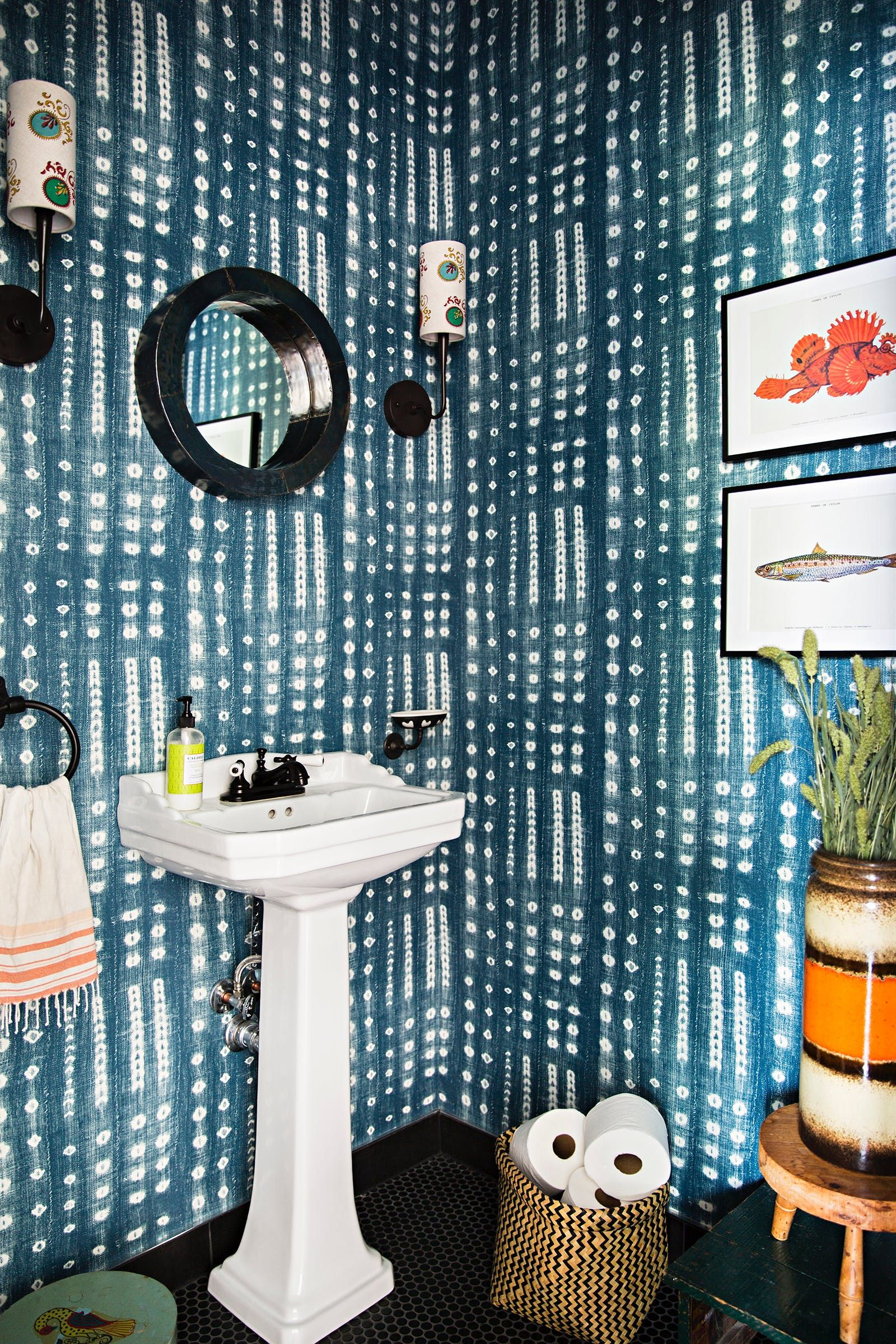 The power room features Studio Four NYC's Shibori Wallpaper, designed by Amber Lewis of Amber Interiors.