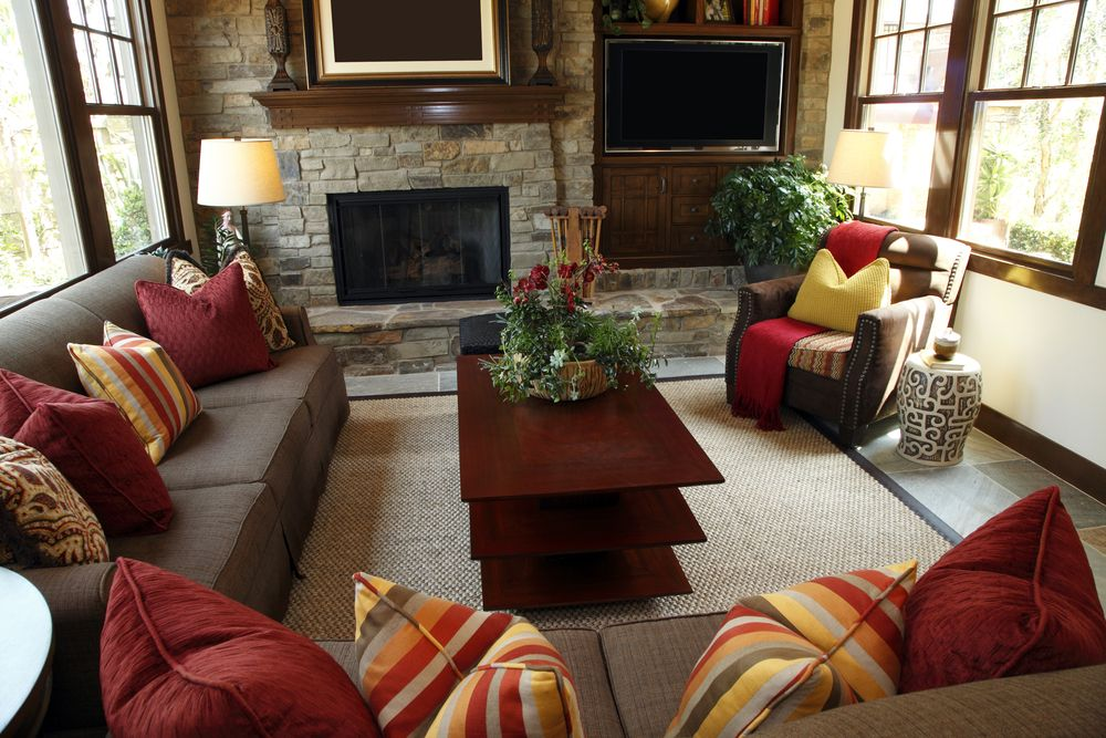 Rustic Living Room Design With Brick Wall Containing A Fireplace And  Television. Brown Sofas Are
