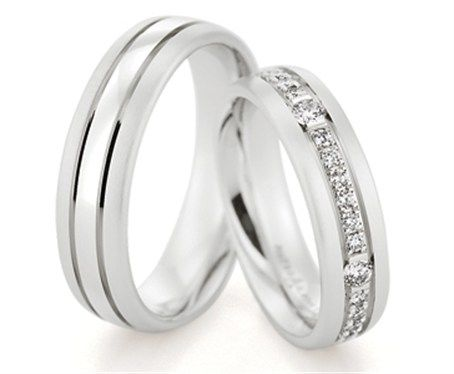 Pair Of Matching Wedding Rings By Bauer Featuring Round Brilliant Cut Diamonds