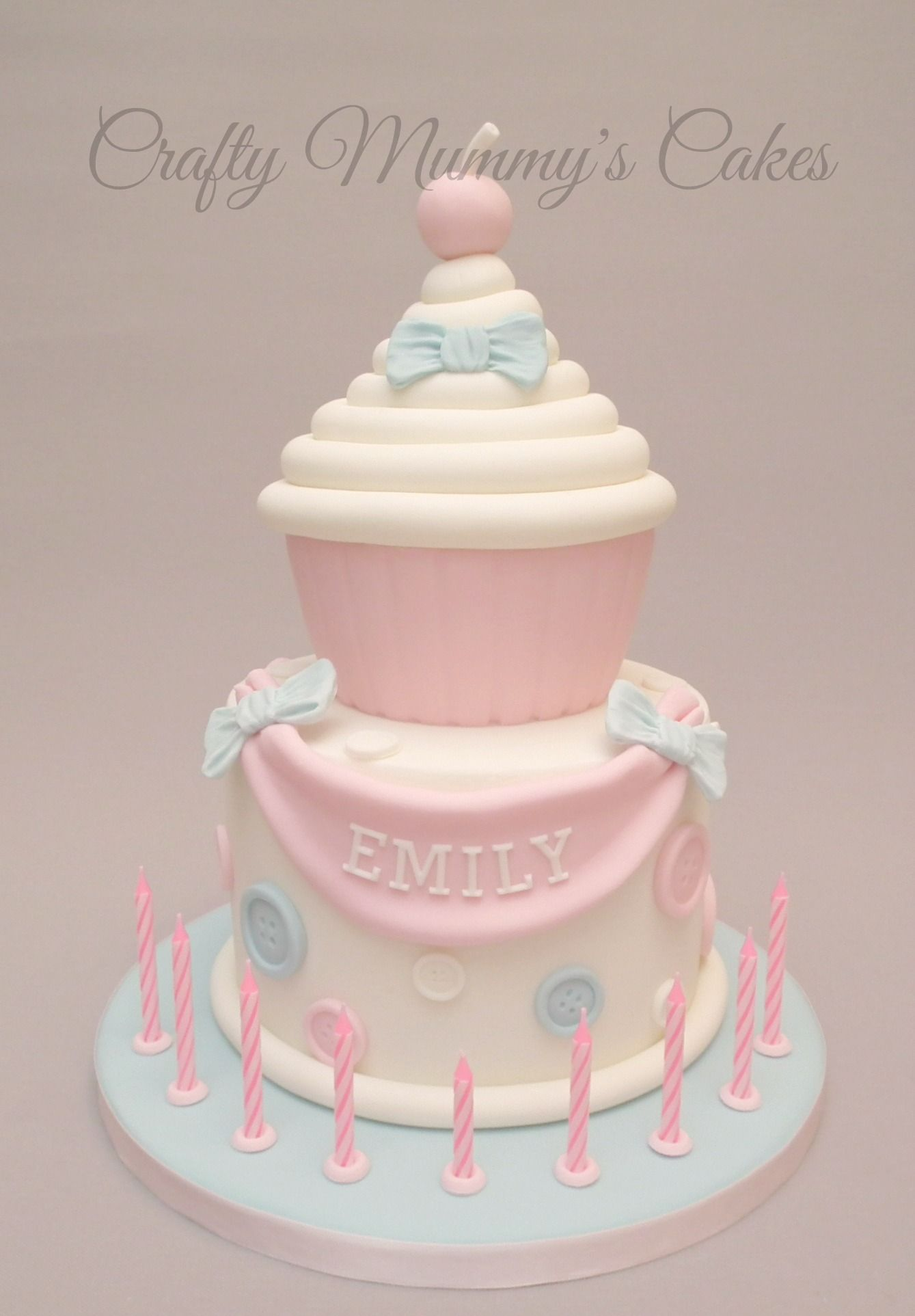 Giant cupcake cake with buttons. https://www.facebook.com/CraftyMummysCakes/