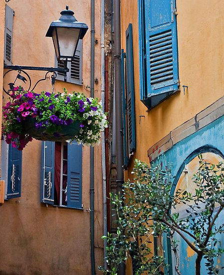 grasse, france. when i was there i loved all these beautiful houses with flowers everywhere
