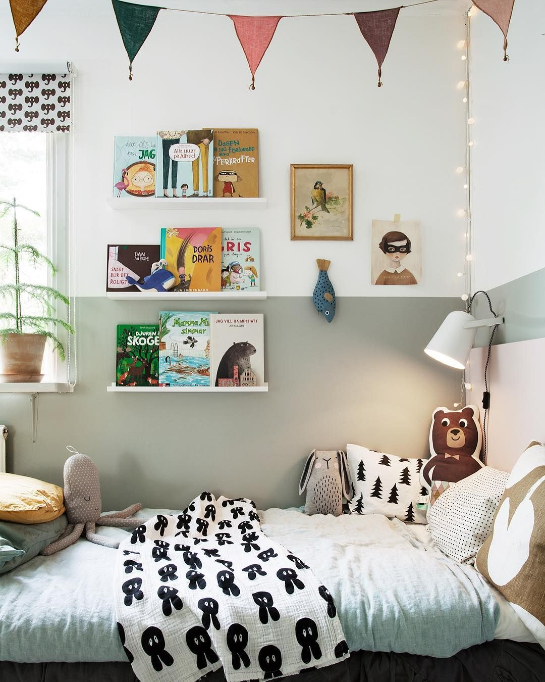 Bed under window  shelf under the window  book shelves by the bed  lamp  twinkly